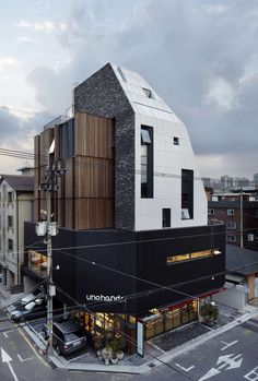 FIRM: L'EAU design Co.,Ltd.; PROJECT: Moai; LOCATION: Seoul, South Korea. Mixed-use housing & commercial structure that has similarity in its purpose, but shifts its facade and profile in response to the context profile in which it is inserted.