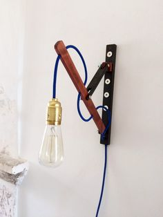 Hey, I found this really awesome Etsy listing at https://www.etsy.com/listing/272582760/wall-lamp-in-wood-with-magnets-magnetic