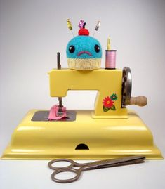 Child's yellow toy sewing machine... Sew adorably cute!