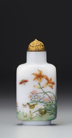 AN ENAMELLED WHITE GLASS 'CAT AND BUTTERFLIES' SNUFF BOTTLE GUYUEXUAN MARK, QING DYNASTY, QIANLONG PERIOD