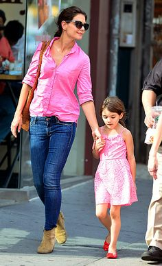Katie Holmes  Pink ladies! Newly single Katie Holmes and her 6-year-old, Suri, roamed New York City in the ultra-girly hue.