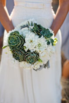 pretty - love the use of succulents - with a touch of peachy dahlias