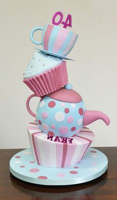 Cupcakes and Teapots.  Vintage chic colours. Love the tilting tiers.