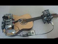 "Robot (internet jargon ""Bot"") plays the Guitar:   It's Lego hehe...  Little Talks Guitar Cover by Lego Mindstorms EV3"