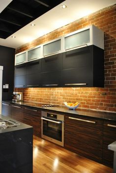 LOVE, LOVE the brick back splash...want to do this to match our family room fire place...everything else about this kitchen, um, no.