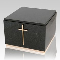 The Immensita Black Granite Cremation Urn is assembled from real natural quarried stone. The urn has a felt bottom to protect the surface were the urn rests on. This wonderful natural stone urn will create a dignified resting place for eternity to come.  Bottom opening plug for the ashes.