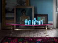 A set of blue ceramics are rested on the flamingo coffee table with antique mirror top. Introducing Matthew Williamson's first ever bespoke furniture collection. Created in collaboration with Nottingham-based sofa manufacturer Duresta, the designs comprise five upholstery ranges and unique occasional pieces.
