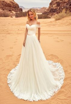 Why would you take such a beautiful dress and then ruin it in sand and a terrible background