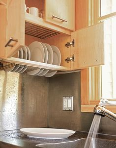 MUST. HAVE. Dish drying rack within bottomless cabinet, drains into sink!