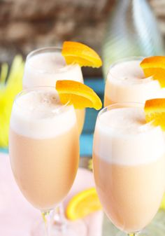 These Pineapple Orange Creamsicle Mimosas are an ethereal blend of pineapple juice, orange sherbet and sparkling Moscato. Only 3 ingredients transforms the basic mimosas into a creamy, dreamy combination that will wow your guests at your next brunch. Summer Drinks, Cocktail Drinks, Fun Drinks, Beverages, Alcoholic Drinks, Holiday Cocktails, Party Drinks, Mixed Drinks, Orange Creamsicle Drink
