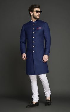 This Turkish Blue Achkan is a smarter and a trendy color option for a traditional achkan. Indian Wedding Suits Men, Indian Groom Wear, Wedding Dress Men, Indian Wedding Outfits, Punjabi Wedding, Indian Weddings, Wedding Couples, Waistcoat Designs, Mens Kurta Designs