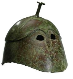Apulian-Corinthian helmet 6th/5th century B.C. Confronting boars Only open eyes, the nasal may be inscribed but is not raised  Private collection