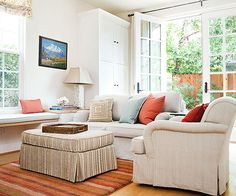 Keep order in the house by filling busy rooms with double-duty furniture. A slim window bench stows a rolling ottoman that transitions between additional seating and a landing spot for a serving tray. And because it's on wheels, the ottoman can always be where it's needed—or tuck away to make room for play.