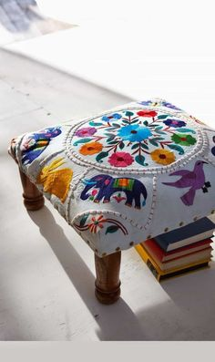 Low footstool upholstered in richly embroidered elephant motif. Fixed around edges with brass studs and finished with polished wooden legs. Mexican Embroidery, Crewel Embroidery, Boho Decor, Gypsy Decor, Home Deco, Diy Furniture, Home Accessories, Upholstery, Sweet Home