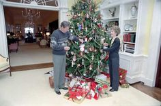 President Ronald Reagan and the First Lady, Nancy Reagan, Decorate the White House residence tree, December 24, 1983