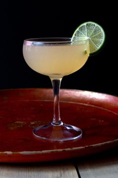 rising sun  Ingredients 1 1⁄2 oz. mezcal 3⁄4 oz. fresh grapefruit juice 1⁄2 oz. fresh lime juice 1⁄2 oz. maraschino Pinch of salt Lime wheel, to garnish Instructions  Combine mezcal, juices, and maraschino in a cocktail shaker filled with ice; shake vigorously and strain into a coupe glass. Garnish with lime wheel. Brandy Cocktails, Mezcal Cocktails, Cocktail Drinks, Cocktail Recipes, Alcoholic Drinks, Beverages, Cocktail Shaker, Drink Recipes, Winter Cocktails