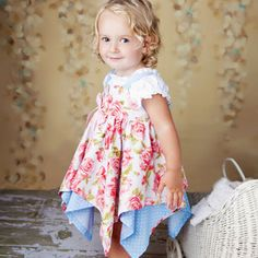 I need a little girl! I love the floral with the blue, so pretty