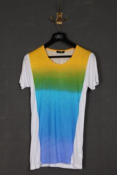 UNCONDITIONAL white round neck tee with rainbow print .