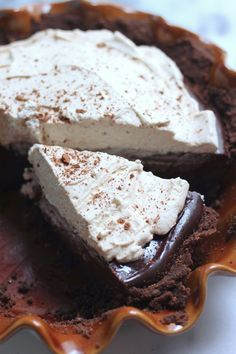 Malted Chocolate Pudding Pie with Chocolate Animal Cracker Crust and Kahlua Whipped Cream...oh so good!
