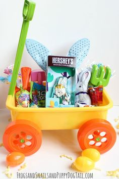 Garden-Themed Easter Basket: Instead of a traditional basket, fill a wagon with plastic gardening toys and candy for a sweet springtime gift. Click through to find more unique Easter gift ideas for boys and girls. Boys Easter Basket, Easter Gift Baskets, Easter Baskets For Toddlers, Easter Gifts For Kids, Custom Easter Baskets, Hoppy Easter, Easter Eggs, Easter Bunny, Easter Table