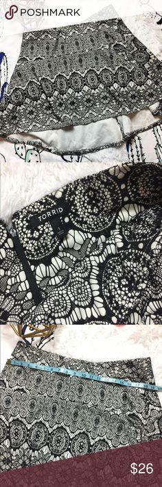 TORRID skirt black white Mr. is in like new condition. It is asymmetrical . torrid Skirts