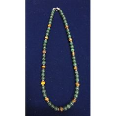 Necklace of green zade with tiger eye and silver rings