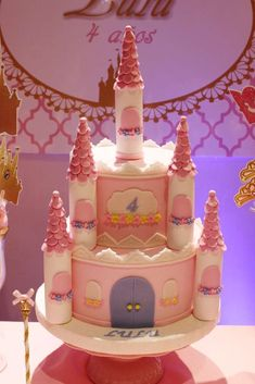 Stunning castle cake at a pink princess party! See more party planning ideas at CatchMyParty.com!
