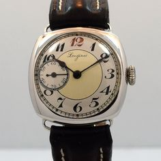 1912 Vintage Longines Cushion-Shaped Sterling Silver watch with Two Tone Silver and Gray Dial with Breguet Arabic Red 12 and Black Numbers. Triple Signed. Swiss Case Very Good Case Original, Case Dime