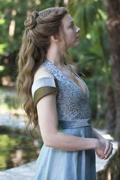 Margaery's romantic half knot and loose waves. See the 7 other best hairstyles on Game of Thrones worth trying IRL.