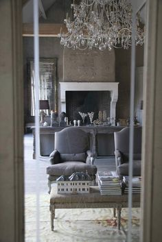 A dream living room - divine! #chalky #French #Rococo #fireplace #linen #white #beams #shabby #slip cover #chair cover #living room #chandelier #grey