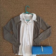 Light blue Cinderella colored button down This sleeveless button down is in great condition. It's sheer, and looks wonderful worn with a sweater, jeans or a skirt, and some cute heels! Vera Wang Tops Blouses