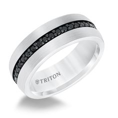 black sapphire and white tungsten carbide eternity wedding band. A solid  white tungsten carbide band with bead set round black sapphires. 874ede0e391