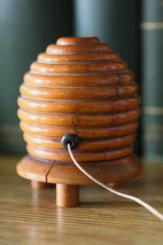 Hive-shaped turned wood string dispenser.