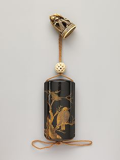 Inrō with Owl and Crows in Tree Period: Edo period (1615–1868) Date: 19th century Culture: Japan Medium: Black lacquer ground with gold and silver togidashi maki-e and e-nashiji Netsuke: seal-shaped with sheaf of rice around peony with pecking bird; ivory Ojime: woven ball; caved and pierced bone | Metropolitan Museum of Art  #inro  #Japanese_art