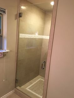 Frameless shower door with BM style handle in Chrome finish