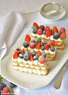 Mille feuille: a slightly-sweet, flaky French pastry topped with fruits, nuts, or chocolate. Can be found at most patisseries (pastry shops) in France. #Pastryshop