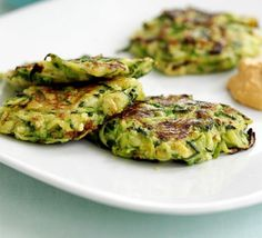 Grate your courgette and add to a pancake batter then fry up these mini veggie patties with chilli dip, from BBC Good Food. Bbc Good Food Recipes, Vegetarian Recipes, Cooking Recipes, Healthy Recipes, Chickpea Fritters, Zucchini Fritters, Potato Cheddar Soup, Food Shows, Veggies