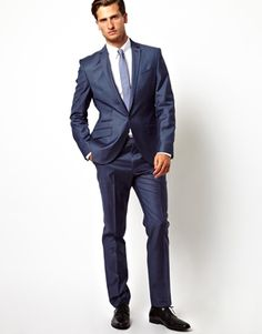 Red Eleven Slim Fit Suit in Blue Sharkskin. My biggest problem with blue is that I look so good in it that if I'm not careful everything I own is going to be blue. This model looks like a douche.