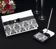 This set includes a 10 x 6 5 guest book and a pen set with 3 25 x 5 25 base Both are covered in beautiful white satin and decorated with black satin