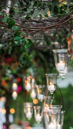 candle light hanging from branches arbor