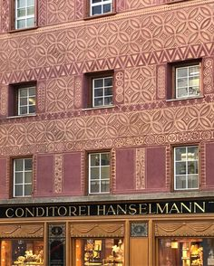 The façade of the Conditorei Hanselmann a sgraffito (and chocolate) tour de force. The entire multistory building in St. Moritz is covered in beautiful sgraffito in the most interesting shades of brick red and straw. Inside the front counter holds a feast of pastries and breads as well as chocolates and marzipans. Behind it sits an intimate wood-paneled dining room with lovely views on Lake St Moritz. The room is a happy one, filled with multigenerational families having lunch,  young…
