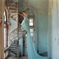 Tim Walker-at design museum pictures.  This photo is a great combination of fashion and composition.  The color of the dress pulls in the color of the walls, and the softness of the dress is a contrast to the hardness of the construction.