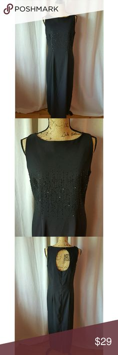 Beautiful I. N. Studio Dress I. N. Studio long Black sleeveless dress. 97% Polyester 3% Spandex. Beautiful Front bead and sequin detail. Zip up back with button at top of a keyhole design. Looks gorgeous on!! I. N.  Studio  Dresses Maxi