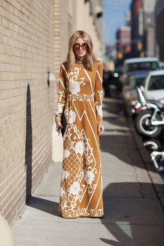 Fall 2013: New York Fashion Week. Seventies style sunnies and maxi dress. Retro inspired street style