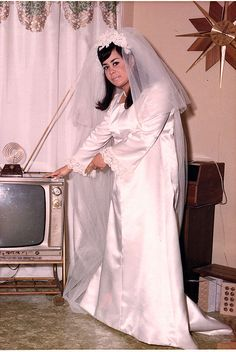 It's my wedding day and I'm dressed in white but let me show you the TV, or  maybe it's the TV stand that was gotten recently for a great price over at Willy's thrift store.