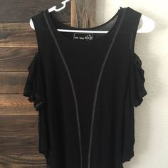 Free people flowy top Free people black flowy top . Scallop cut short sleeve top . Size small Free People Tops Tees - Short Sleeve