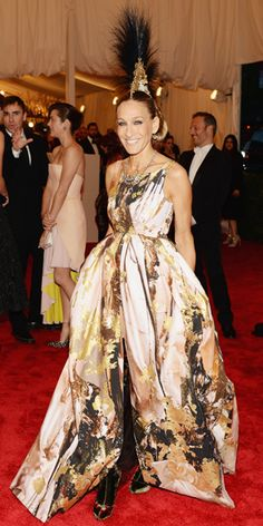 I have nothing against SJP, but...2013--At the Metropolitan Museum of Art's annual gala, the actress fully embodied the punk theme in a gold, paint-splattered Giles gown, that she paired with a custom Philip Treacy mohawk headpiece.