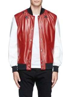 Living up to its reputation as a fashion power house, Givenchy constructed this bomber jacket with red leather and white leather sleeves to amp up off-duty outfits with a bold burst of energy. Finely cut-out around the neckline, this piece is embellished with black leather star inserts to steal the spotlight with a dramatic and dapper finish. £2,070 at lane crawford