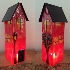 Red fused house with candle inside.