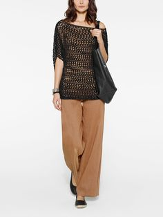 Camel and black color combo by Belgian fashion designer Sarah Pacini. Wide leg pants and boxy knitted mesh pullover